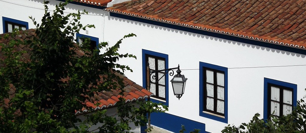 white and blue painted house