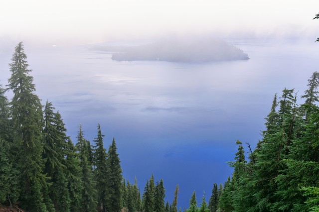crater lake viewing with pines and island in the middle