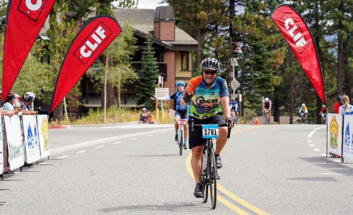 bike rider crossing finish line